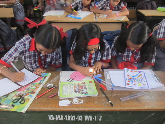 Students participating in drawing competition held on Children's Day 2017